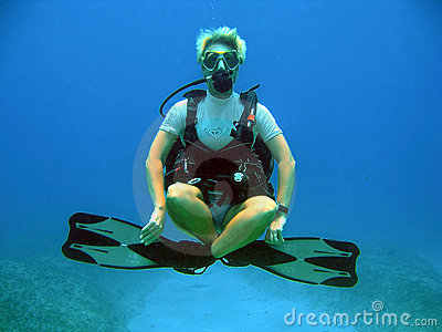 Diver weightless underwater