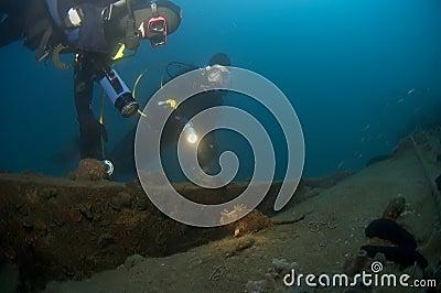 Divers exploring a wreck, Croatia