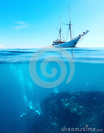Free Divers On A Shipwreck Royalty Free Stock Photo - 26888115