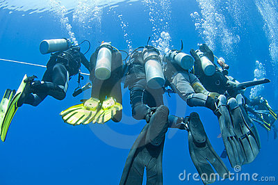 Divers on a rope underwater