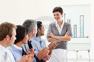 A diverse business group applauding a presentation