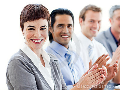 A diverse business group clapping a presentation