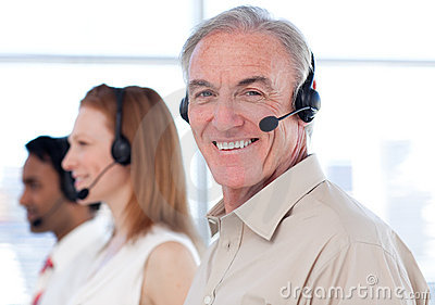 A diverse business group working in a call center
