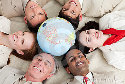 A diverse business people lying around a globe