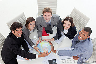A diverse business team holding a terrestrial glob
