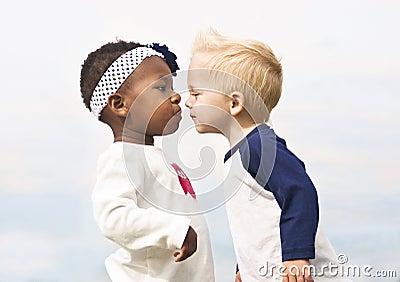 Diverse Little Kids First Kiss