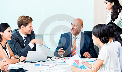 Diversity team in business development meeting with charts