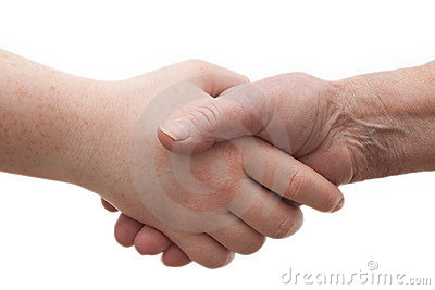 Diversity - young and old females shaking hands