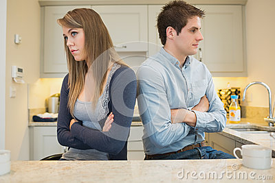 Divided couple with arms crossed