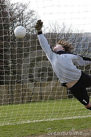 A Diving goalkeeper missing a save !!