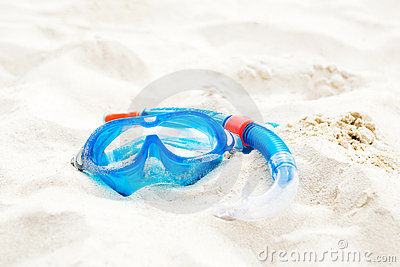 Diving mask in sand