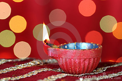 Diwali Diya with blurred festive lights