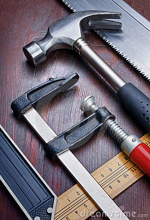 Free DIY Tools Over A Wood Panel Stock Images - 23642644