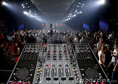 DJ desk in a nightclub party with lightshow Editorial Stock Image