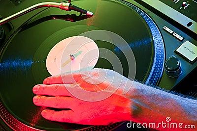 DJ hand scratches vinyl