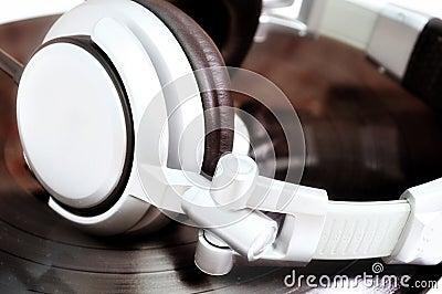 DJ headphones lying over old vinyl