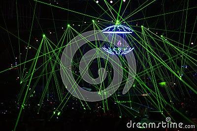 DJ in laser beams