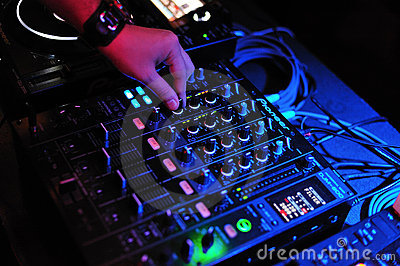Dj mix and playing with pioneer mixer and console Editorial Image