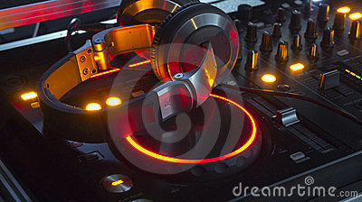 Dj mixer console and headphones