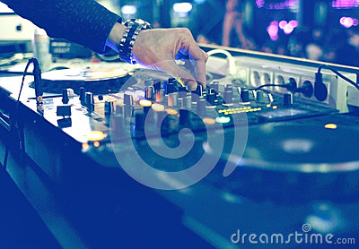 DJ mixing desk at party