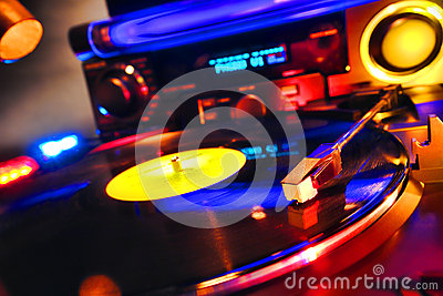 DJ Turntable Playing Vinyl Record in Dance Club