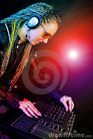 Dj woman playing music by mixer