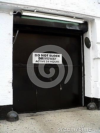 Do Not Block Driveway Active 24 Hours -- Generic door and active driveway