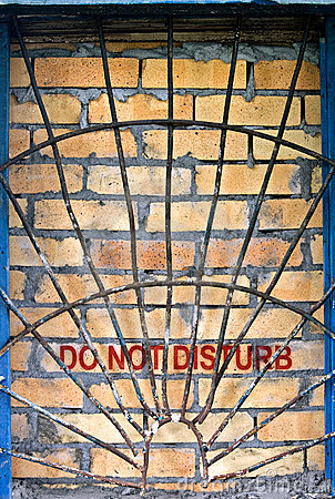 Do not disturb label on the brick-encased window
