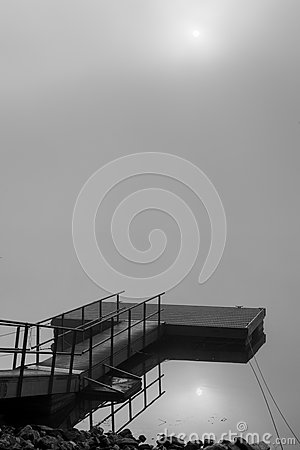 Free Dock In The Fog With Sun Reflection Royalty Free Stock Images - 29037149