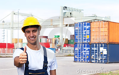 Docker on a seaport showing thumb up