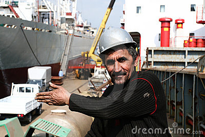 Dockyard worker showing something