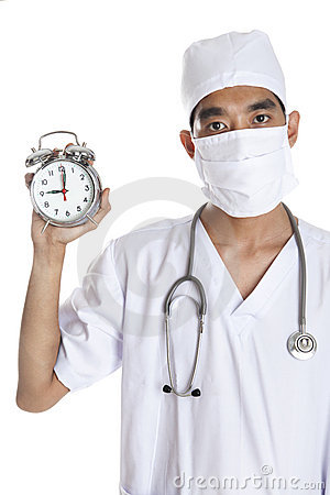 Doctor With An Alarm Clock Stock Photo - Image: 23310740