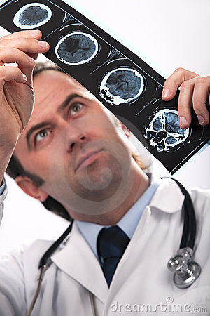 Doctor analyzing a CT scan