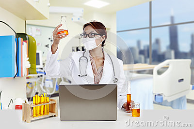 Doctor analyzing yellow solution at the hospital