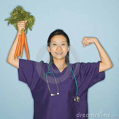 Free Doctor And Carrots. Royalty Free Stock Photography - 2425977