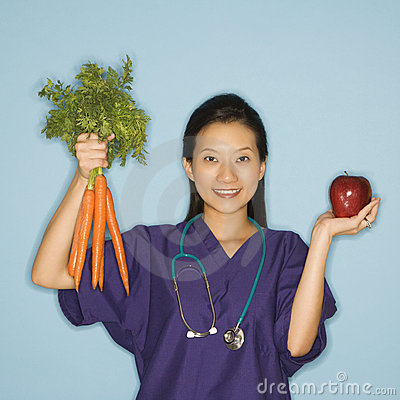 Free Doctor, Apple And Carrots. Stock Photography - 2431952