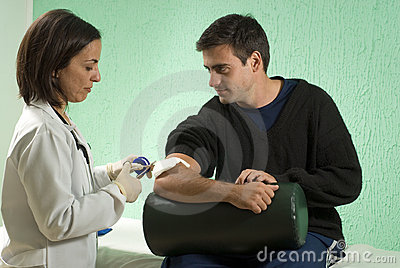 Doctor Bandaging Patient s Arm - Horizontal