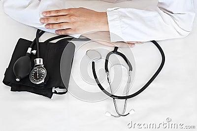 Doctor with blood pressure gauge