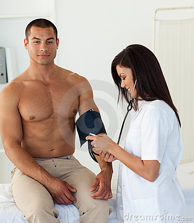 Doctor checking the blood pressure of a patient