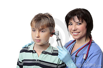 Doctor checking childs ears