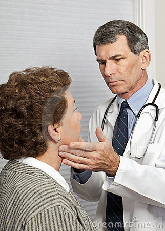 Doctor Checking Female Patient For Flu Symptoms