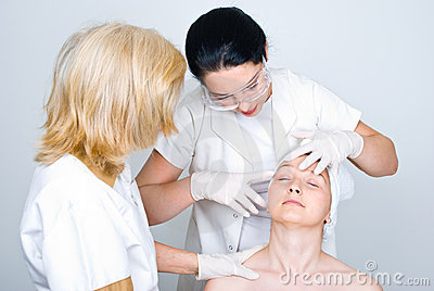 Doctor checking patient woman skin