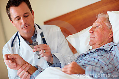 Doctor checking the pulse rate of a patient