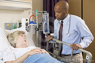 Doctor Checking Up On Patient In Hospital