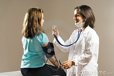 Doctor Checks Girl s Heartbeat. Horizontal