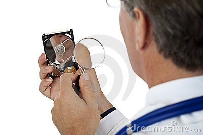Doctor checks hard disk with magnifying glass