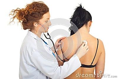 Doctor checkup back woman