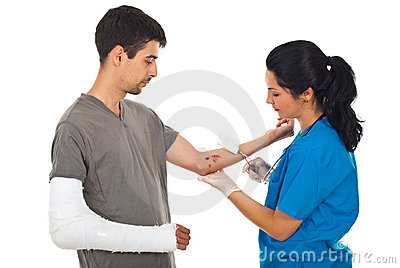 Doctor cleaning wound to injured man