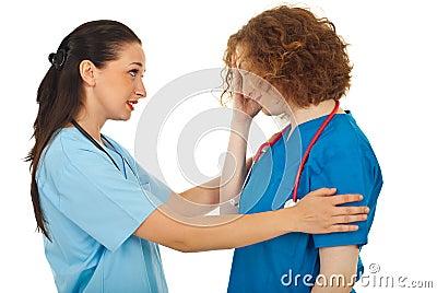 Doctor comforting her colleague