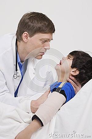 Doctor comforting little boy patient